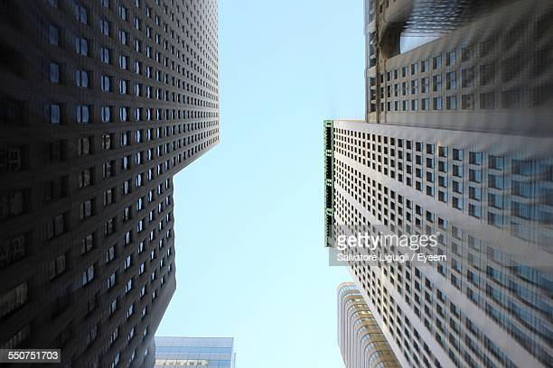 Directly Below Shot Of Skyscrapers Against Clear Blue Sky