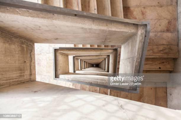 directly below shot of spiral staircase - valletta stock pictures, royalty-free photos & images