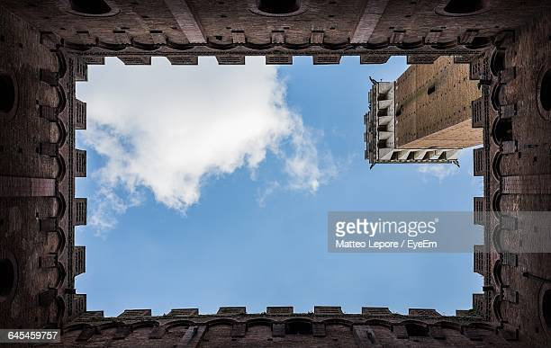 Directly Below Shot Of Torre Del Mangia Against Sky