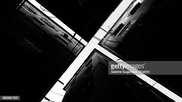 directly below view of buildings in city - x photos stock photos and pictures