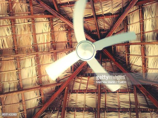 Directly Below View Of Ceiling Fan In Cottage