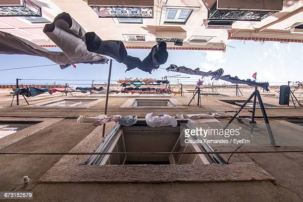 Directly Below View Of Clothesline Amidst Building