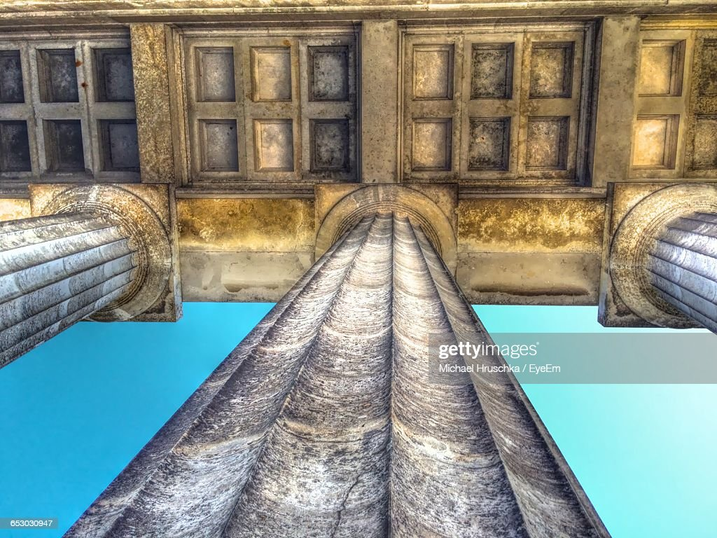 Directly Below View Of Colonnades Against Sky : Stock Photo
