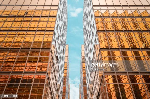 directly below view of modern golden architecture - tsim sha tsui stock pictures, royalty-free photos & images