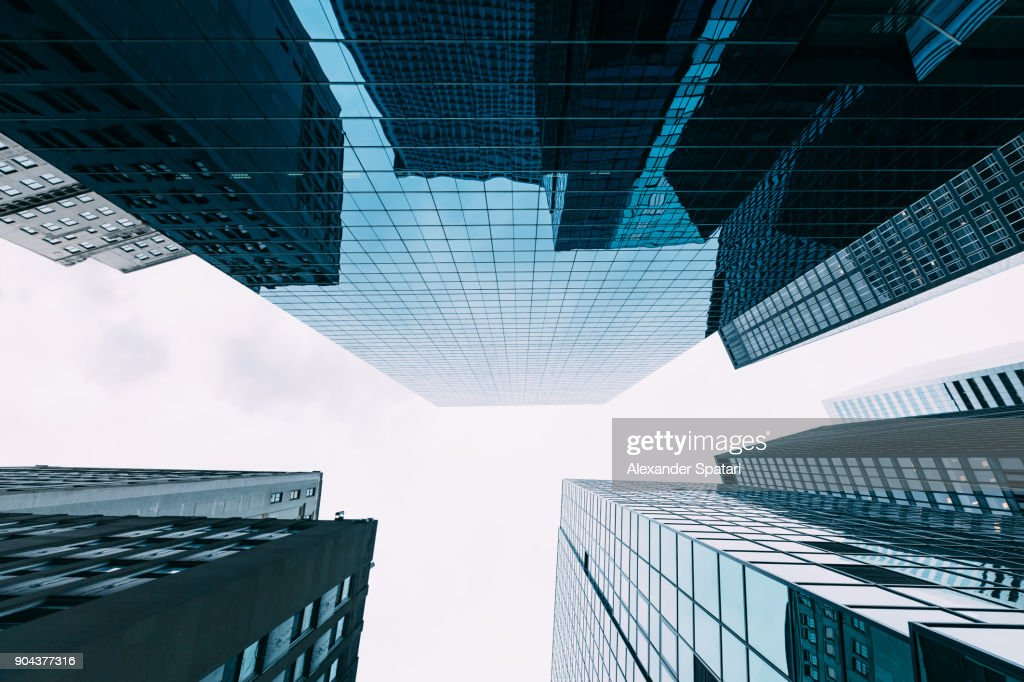 Directly below view of modern office buildings in Manhattan Fincancial District, New York, USA : Stock Photo