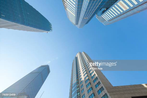 """Directly below view of modern skyscrapers in financial district, CBD, Beijing, China"""