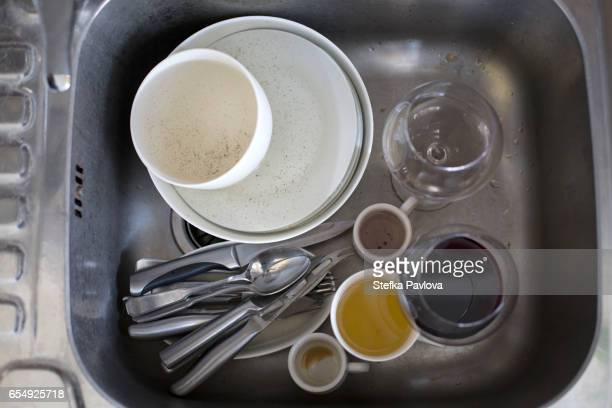 Directly From Above Shot Of Dirty DIshes In Kitchen Sink