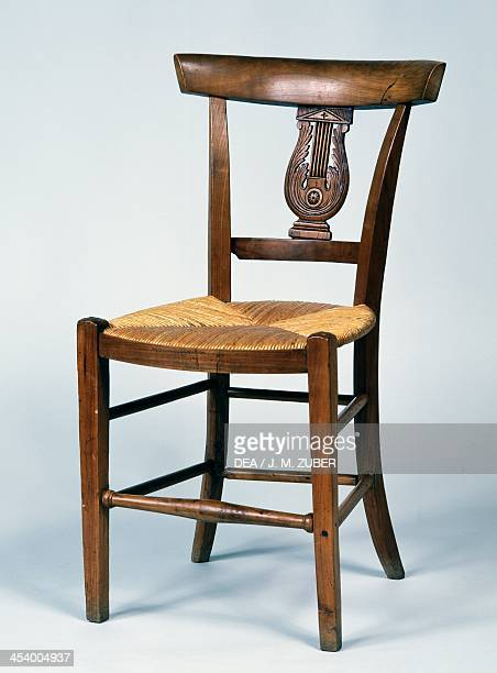Directoire style wild cherry wood armchair and chair with wicker seat France late 18thearly 19th century