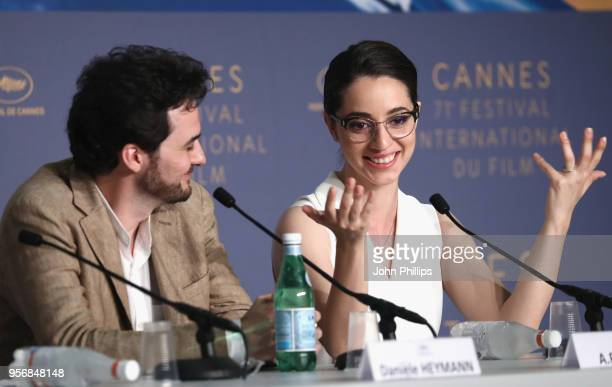Director AB Shawky and actress Shahira Fahmy raising her hands attend the press conference for 'Yomeddine' during the 71st annual Cannes Film...