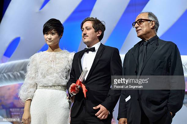 Director Abbas Kiarostami and actress Li Yuchun present on stage the Short Film Special Distinction award to director Simon Mesa Soto for his film...