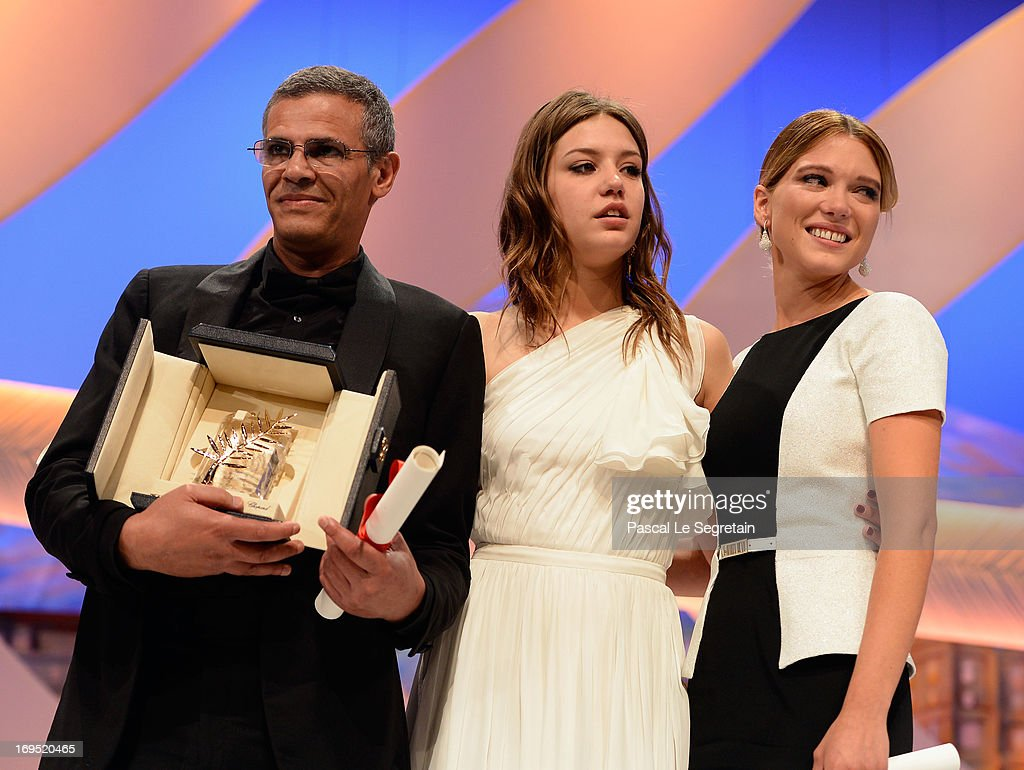 Director Abdellatif Kechiche, actresses Adele Exarchopoulos and Lea Seydoux speak on stage after 'La Vie D'adele' receives the Palme D'or' at the Inside Closing Ceremony during the 66th Annual Cannes Film Festival at the Palais des Festivals on May 26, 2013 in Cannes, France.