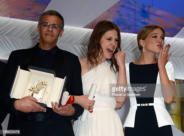Director Abdellatif Kechiche actresses Adele Exarchopoulos and Lea Seydoux speak on stage after 'La Vie D'adele' receives the Palme D'or' at the...
