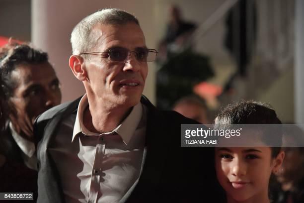 Director Abdellatif Kechiche attends the premiere of the movie 'Mektoub My Love Canto Uno' presented in competition at the 74th Venice Film Festival...