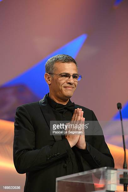Director Abdellatif Kechiche on stage after 'La Vie D'adele' receives the Palme D'or' at the Inside Closing Ceremony during the 66th Annual Cannes...