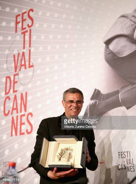 Director Abdellatif Kechiche poses with the 'Palme d'Or' for 'La Vie D'adele' at the Palme D'Or Winners Press Conference during the 66th Annual...