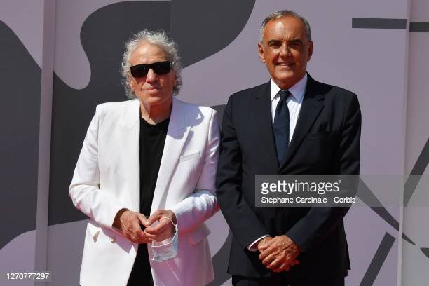 Director Abel Ferrara and Director of 77 Mostra Internazionale d'Arte Cinematografica Alberto Barbera walk the red carpet ahead of the movie...