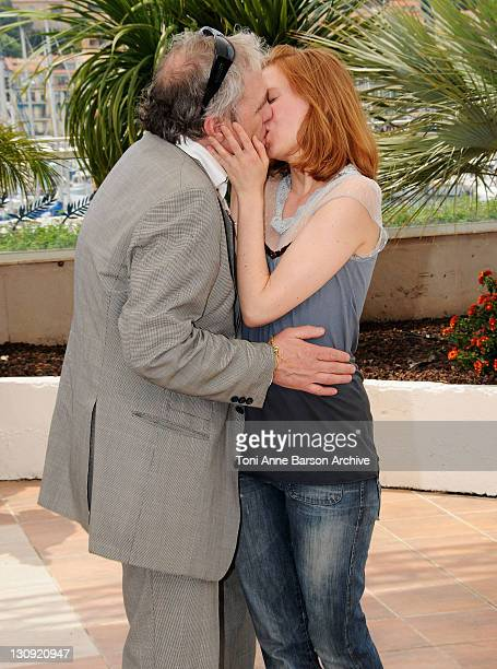 Director Abel Ferrara kisses actress Shanyn Leigh as they attend the Chelsea on the Rocks photocall at the Palais des Festivals during the 61st...
