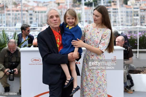 US director Abel Ferrara poses with his daughter US actress Anna Ferrara and wife Moldovan actress Cristina ChiriacFerrara during a photocall for the...