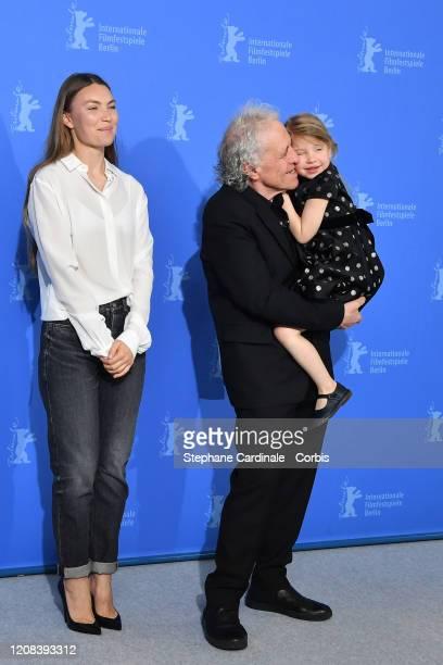 Director Abel Ferrara with his wife Cristina Chiriac and daughter Anna Ferrara attend the Siberia photo call during the 70th Berlinale International...