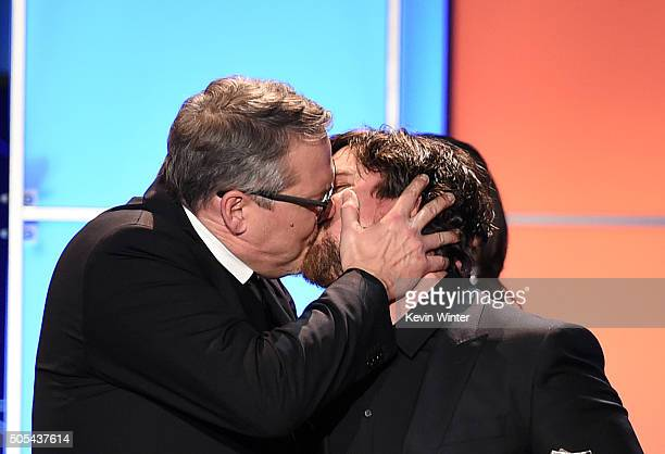 Director Adam McKay and actor Christian Bale kiss onstage as they accept the Best Comedy award for 'The Big Short' during the 21st Annual Critics'...