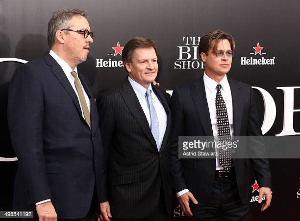 Director Adam McKay author Michael Lewis and actor Brad Pitt attend 'The Big Short' New York premiere at Ziegfeld Theater on November 23 2015 in New...