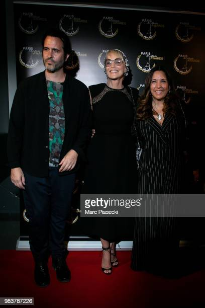 Director Adam Rothlein actress Sharon Stone and director Price Arana attend the Paris Art and Movie Awards ceremony at Le Grand Rex on June 25 2018...