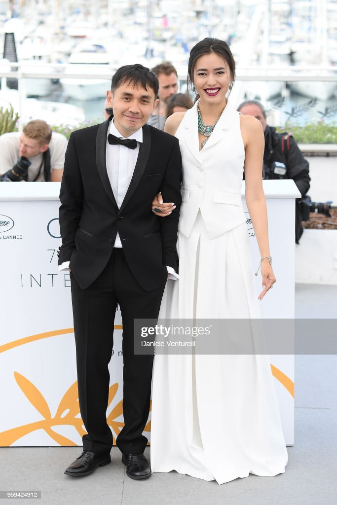 Director Adilkhan Yerzhanov and actress Dinara Baktybaeva attend the photocall for the 'The Gentle Indifference Of The Word' during the 71st annual Cannes Film Festival at Palais des Festivals on May 17, 2018 in Cannes, France.