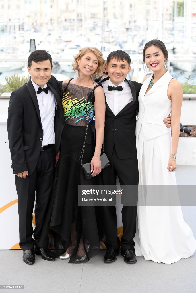 Director Adilkhan Yerzhanov (CR) and actress Dinara Baktybaeva (R) attend the photocall for the 'The Gentle Indifference Of The Word' during the 71st annual Cannes Film Festival at Palais des Festivals on May 17, 2018 in Cannes, France.
