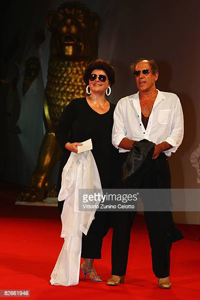 Director Adriano Celentano and Claudia Mori attend the Yuppi Du premiere at the Sala Grande during the 65th Venice Film Festival on September 4 2008...