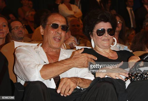 Director Adriano Celentano and Claudia Mori attend the Yuppi Du premiere at the Sala Grande during the 65th Venice Film Festival on September 4, 2008...