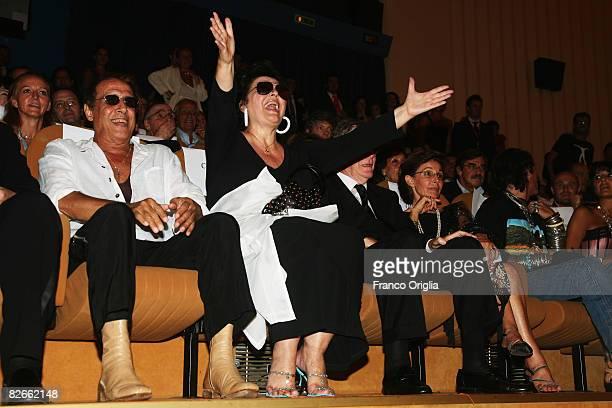 Director Adriano Celentano and Claudia Mori attend the Yuppi Du premiere at the Sala Grande during the 65th Venice Film Festival on September 4 2008...