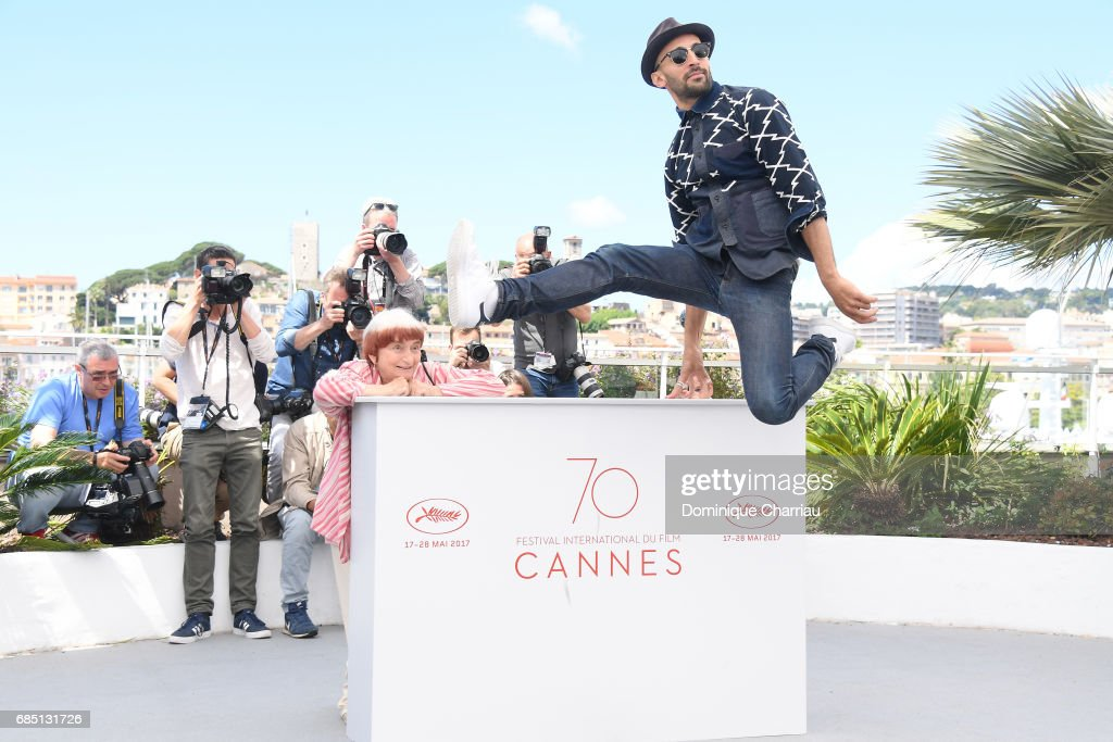 Director Agnes Varda (L) and Director JR attend the 'Faces, Places (Visages, Villages)' photocall during the 70th annual Cannes Film Festival at Palais des Festivals on May 19, 2017 in Cannes, France.