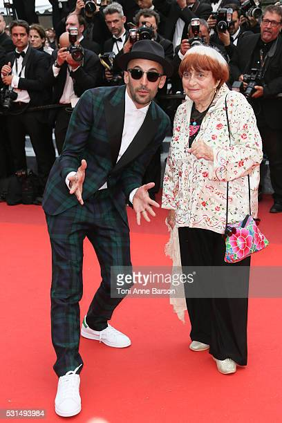 """Director Agnes Varda and French photographer JR attend a screening of """"The BFG"""" at the annual 69th Cannes Film Festival at Palais des Festivals on..."""