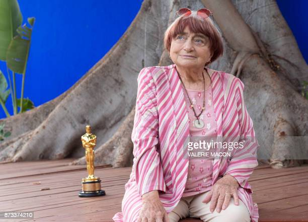 TOPSHOT Director Agnes Varda poses with her Academy of Motion Picture Arts And Sciences' 9th Annual Governors Awards Honorary Award Statue during a...