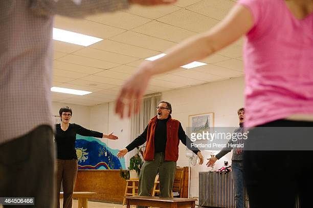 Director Al D'Andrea leads the actors for 'The Maine Dish A Feast of Plays About Food' in a voice warmup exercise before rehearsal in South Portland...