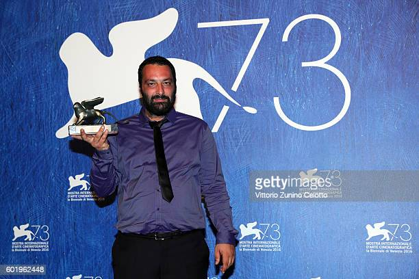 Director Ala Eddine Slim poses with the Lion of the Future 'Luigi de Laurentiis' Venice award for the movie 'The Last of Us' during the award winners...