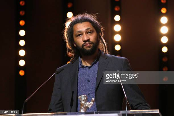 Director Alain Gomis speaks on the stage as he receives the Silver Bear for the Film 'Felicite' at the awards ceremony the closing ceremony of the...