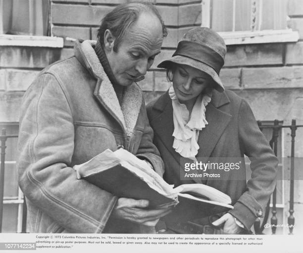 Director Alan Bridges discusses the script with actress Sarah Miles on the set of the Columbia Pictures film 'The Hireling' 1973