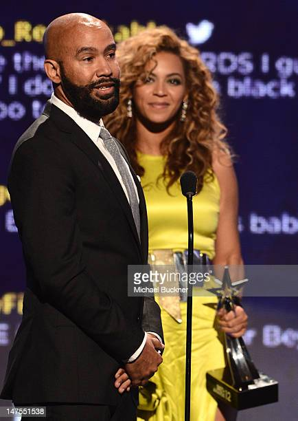 Director Alan Ferguson and singer Beyonce accept t he award for Video Director of the Year onstage during the 2012 BET Awards at The Shrine...