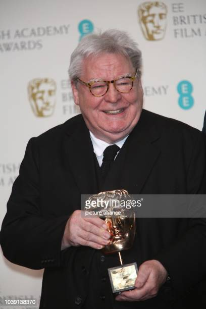 Director Alan Parker poses in the press room of the EE British Academy Film Awards at The Royal Opera House in London England on 10 February 2013...