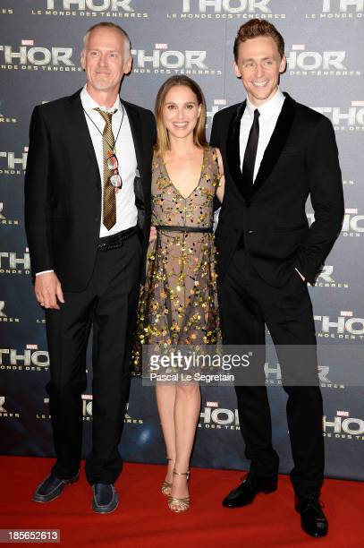 Director Alan Taylor actors Natalie Portman and Tom Hiddleston attend 'Thor The Dark World' Premiere at Le Grand Rex on October 23 2013 in Paris...