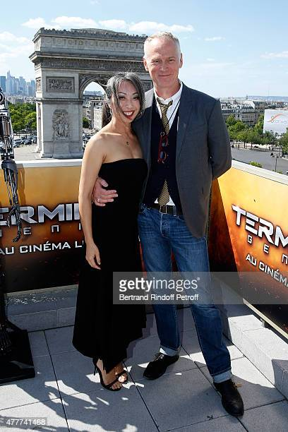 Director Alan Taylor and his companion Jane Wu attend the France Photocall of 'Terminator Genisys' at the Publicis Champs Elysees on June 19 2015 in...
