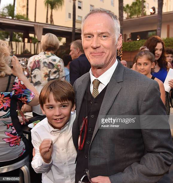Director Alan Taylor and his son pose at the after party for the premiere of Paramount Pictures' Terminator Genisys at the Roosevelt Hotel on June 28...