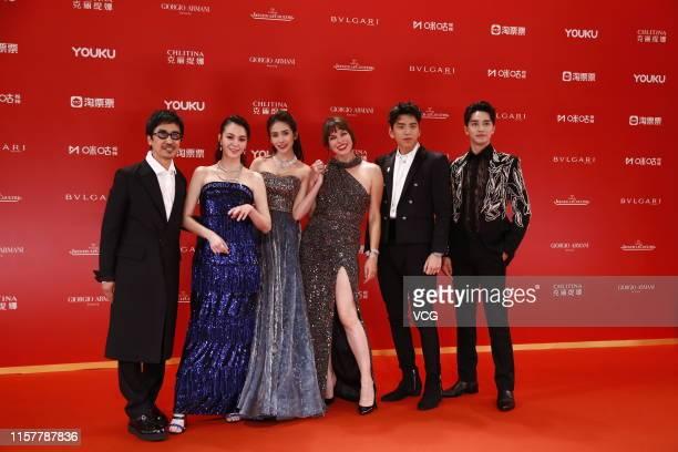 Director Alan Yuen actors Sandrine Pinna Liu Meitong Milla Jovovich Darren Wang Talu and Xu Weizhou attend the Closing and Golden Goblet Awards...