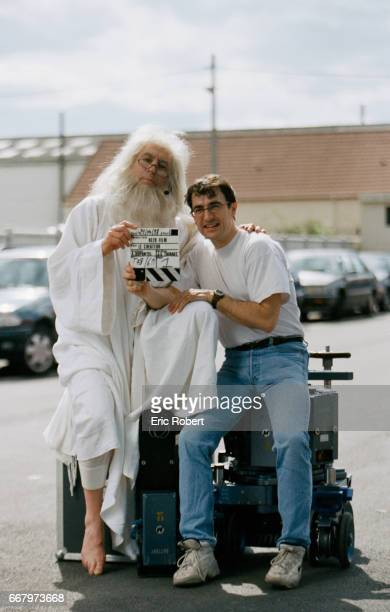 Director Albert Dupontel holds a clapper board with actor Terry Jones who plays the role of God on the set of the 1999 French movie Le Createur...