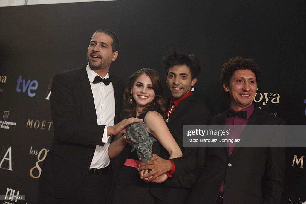 Director Alejandro Brugues (L) holds his award for the Best Iberoamerican Film for the film 'Juan de los muertos' during the 2013 edition of the 'Goya Cinema Awards' ceremony at Centro de Congresos Principe Felipe on February 17, 2013 in Madrid, Spain.