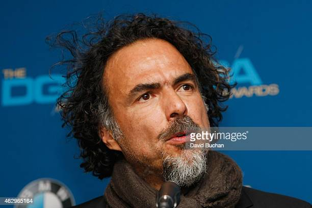 Director Alejandro G Inarritu winner of the Outstanding Directorial Achievement in Feature Film for 2014 award for 'Birdman or ' poses in the press...
