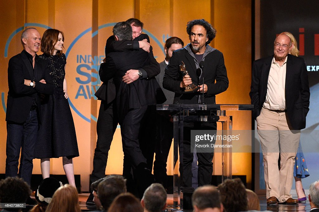 Director Alejandro Gonzalez Inarritu (C) accepts Best Feature for 'Birdman' onstage with actors Michael Keaton and Emma Stone and producer Arnon Milchan during the 2015 Film Independent Spirit Awards at Santa Monica Beach on February 21, 2015 in Santa Monica, California.