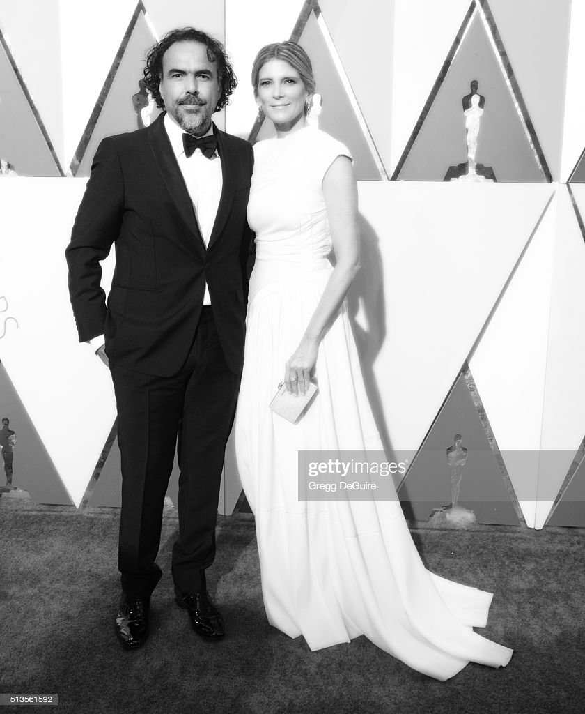 Director Alejandro Gonzalez Inarritu and Maria Eladia Hagerman arrive at the 88th Annual Academy Awards at Hollywood & Highland Center on February 28, 2016 in Hollywood, California.