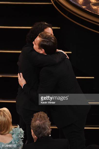 Director Alejandro Gonzalez Inarritu embraces actor Leonardo DiCaprio after winning the Best Director award for 'The Revenant' onstage during the...